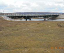 Выполнены работы по устройству временного моста для обеспечения проезда через р.Манзурка на км 0+007 автомобильной дороги Подъезд к п. Заречное